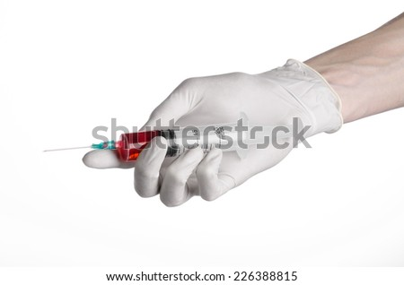 Doctor's hand holding a syringe, white-gloved hand, a large syringe, medical issue, the doctor makes an injection, white background, isolated, white gloves doctor, ebola test, red medication - stock photo