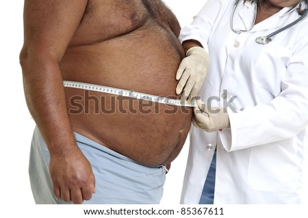 Doctor's hand with very fat male patient - stock photo