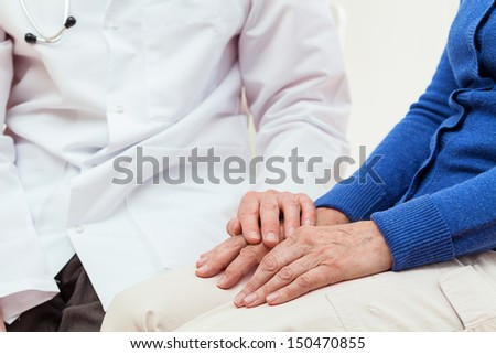 Doctor's help for an elderly woman, isolated background - stock photo