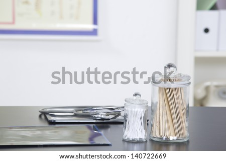 Doctor's office desk with medical supplies documents stethoscope - stock photo