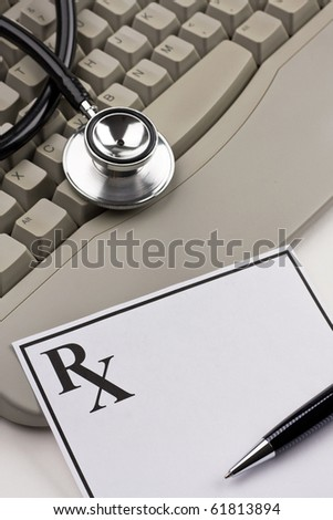 Doctor's stethoscope, blank prescription and computer keyboard.  Concept of health care. - stock photo