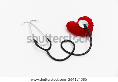 Doctor's stethoscope listening to a healthy red heart, health concept, taking care about health - stock photo