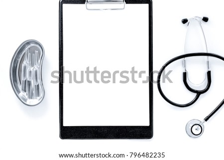 Doctor's table. Clip pad, stethoscope and cuvette with ampoulie
