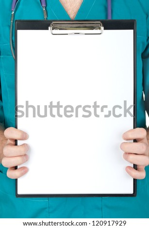 Doctor showing blank clipboard to write it on your personal message or advice - stock photo