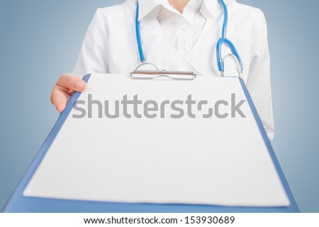 Doctor showing Clipboard with blank sheet. Space for text - stock photo