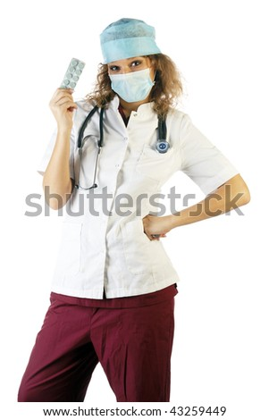 Doctor showing pills and posing in studio isolated on white background