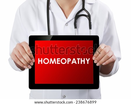 Doctor showing tablet with HOMEOPATHY text.  - stock photo