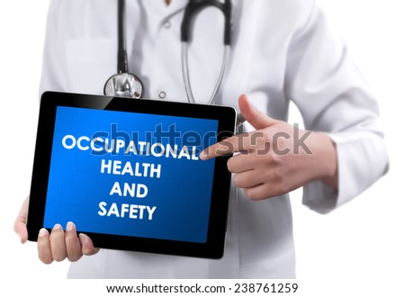 Doctor showing tablet with OCCUPATIONAL HEALTH AND SAFETY text.  - stock photo