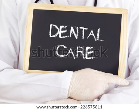 Doctor shows information: dental care - stock photo