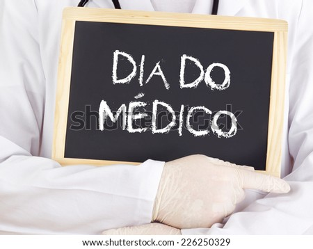 Doctor shows information: Doctors Day in portuguese - stock photo