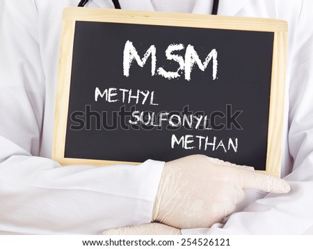Doctor shows information: MSM in german language - stock photo