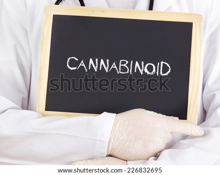 Doctor shows information on blackboard: cannabinoid - stock photo