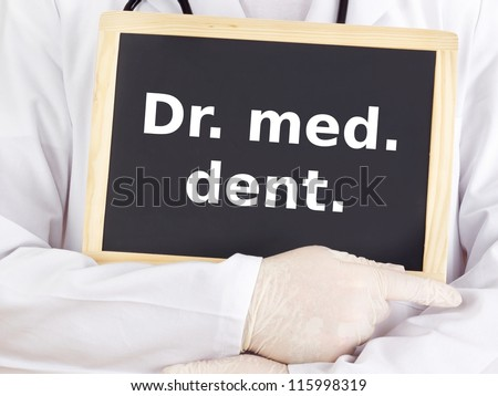 Doctor shows information on blackboard: dr med dent