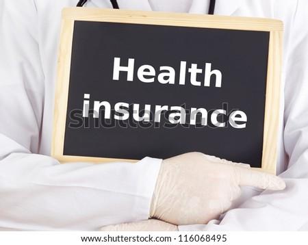 Doctor shows information on blackboard: health insurance - stock photo