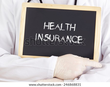 Doctor shows information on blackboard: health insurance - stock photo