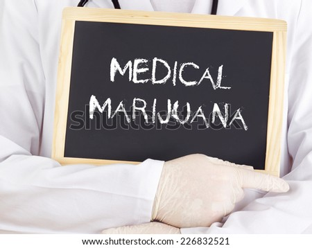 Doctor shows information on blackboard: medical marijuana - stock photo