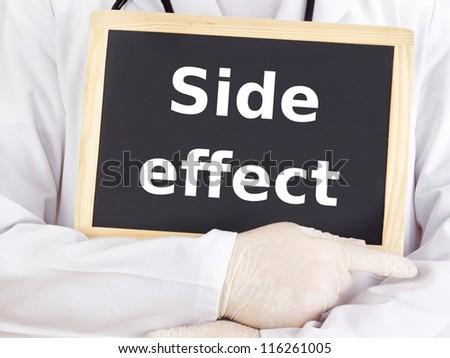 Doctor shows information on blackboard: side effect - stock photo