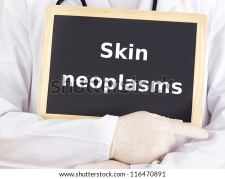 Doctor shows information on blackboard: skin neoplasms