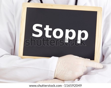 Doctor shows information on blackboard: stop