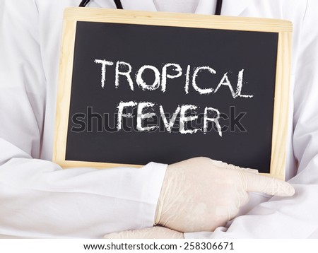 Doctor shows information on blackboard: Tropical fever - stock photo