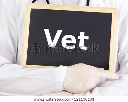 Doctor shows information on blackboard: vet - stock photo