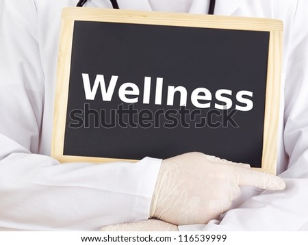 Doctor shows information on blackboard: wellness