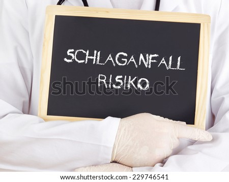 Doctor shows information: stroke risk in german language - stock photo