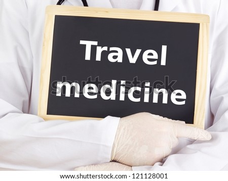 Doctor shows information: travel medicine - stock photo