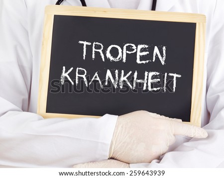 Doctor shows information: Tropical disease in german - stock photo