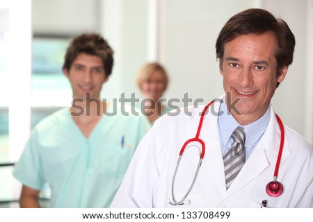 Doctor smiling. - stock photo