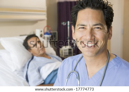 Doctor Smiling In Patients Room - stock photo