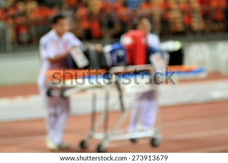 Doctor stand by with Stretcher and hospital trolley for help  - stock photo