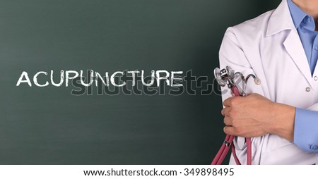 Doctor Standing front of Blackboard written ACUPUNCTURE - stock photo