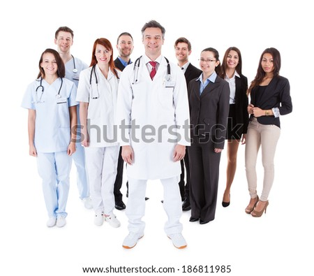 Doctor standing in front of his team. Isolated on white - stock photo