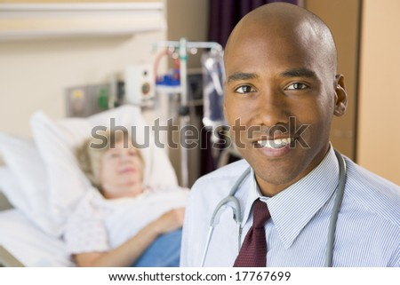 Doctor Standing In Patients Room - stock photo