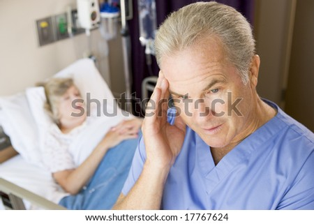 Doctor Standing In Patients Room,Looking Frustrated - stock photo