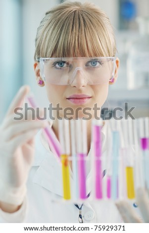 doctor student  female researcher holding up a test tube in chemistry bright labaratory - stock photo