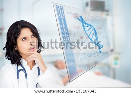Doctor studying virtual screen showing DNA helix in hospital ward - stock photo