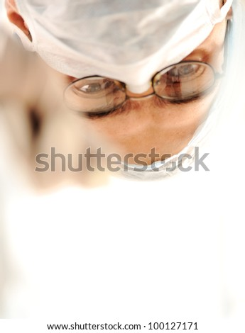 Doctor surgeon before going into surgery - stock photo