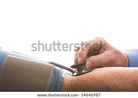 Doctor taking blood pressure - stock photo