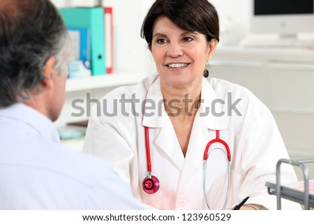 Doctor talking to a patient - stock photo
