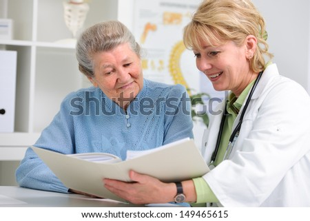 doctor talking to her female patient at office - stock photo