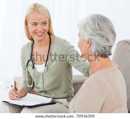 Doctor talking with her patient - stock photo