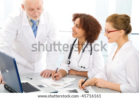 Doctor teaches a student - stock photo