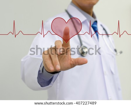 Doctor touching heart shape button on EKG graph monitor. - stock photo