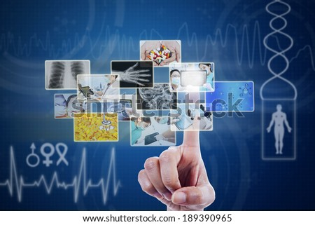 Doctor touching pictures on blue virtual screen - stock photo