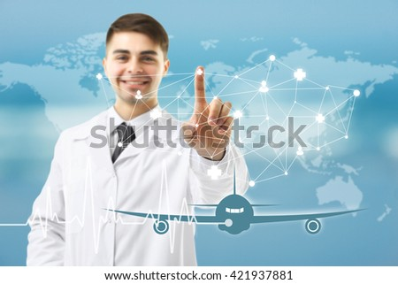 Doctor touching virtual screen. Medical tourism concept - stock photo