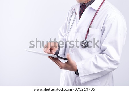 doctor using digital tablet pc - stock photo