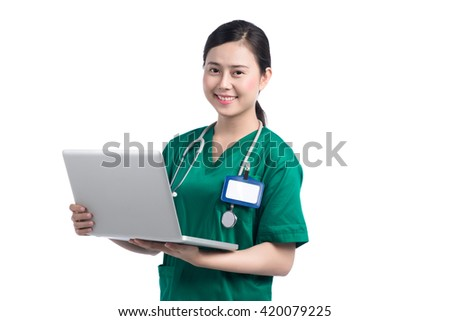 Doctor using laptop. Young doctor woman smile face with stethoscope on white background. - stock photo