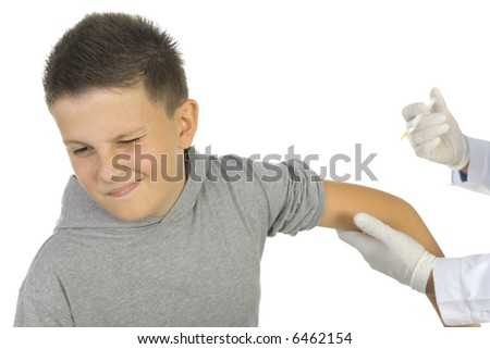 Doctor vaccinating a boy. White background.